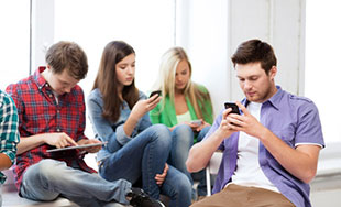 Youths using mobile devices
